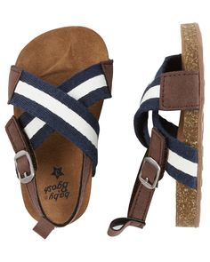 Crafted with cork soles and handsome crisscross stripes, these sandal crib shoes are perfect for his summer outfits.