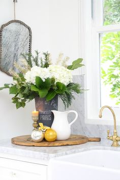 Farmhouse Glam Christmas decor .  Tour my newly renovated kitchen in our 1886 Victorian Farmhouse. Unlacquered brass, factory doors, white paint, Cararra Marble, silver & gold Christmas tree & more.  AND, there are other homes to tour too!  All on the Styled & Set Holiday Entertaining Blog tour