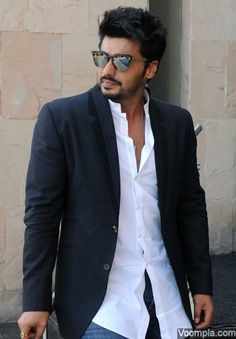 Dashing dude Arjun Kapoor styles up in a blazer, chinese collared white shirt and jeans. via Voompla.com
