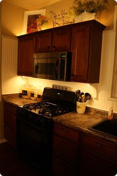 Thrifty Decor Chick: Mood lighting in the kitchen - Above and below the cabinets