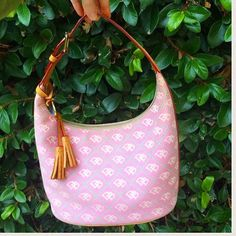 | Dooney & Bourke | Purse Beautiful pink Dooney & Bourke purse with leather accents.  Hardly used and in excellent condition.  Please see pictures for interior marks near the zipper and above pocket.  It is a beautiful bag!  Please let me know if you have any questions!  ✨Offers always welcome! ✨ Dooney & Bourke Bags Shoulder Bags