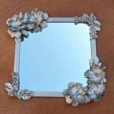"Clever Dollar Store Ideas That Will Have You Saying, ""How'd They Think Of That?"" Make this Anthropologie-inspired mirror with a dollar-store mirror and silk flowers.Make this Anthropologie-inspired mirror with a dollar-store mirror and silk flowers. Diy Projects To Try, Crafts To Make, Fun Crafts, Craft Projects, Craft Tutorials, Spray Paint Projects, Dollar Store Mirror, Mirror Store, Flower Mirror"