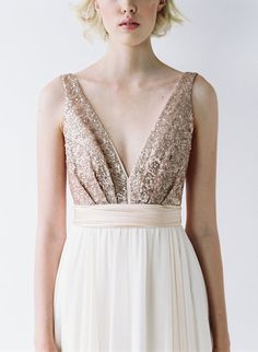 This gown features a plunging neckline, open sides, and a striking back. The skirt is made on the bias using almond chiffon, which flows effortlessly from the waist to the floor. The gown is tied together beautifully with a silk bow that is both elegant and dramatic.  The bodice is lined with a stretch satin, and lies close to the skin. Minimal support is provided through the straps and waistband.  The length measures roughly 46″ at the front and roughly 51″ at the back. It can easily be…