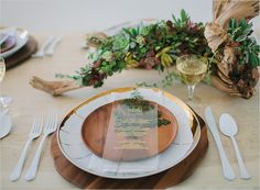 love the opaque menus placed over natural leaves at each place setting - brilliant.