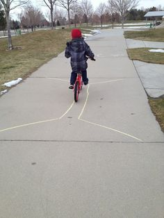 Chalk drawn obstacle course for biking with the kids
