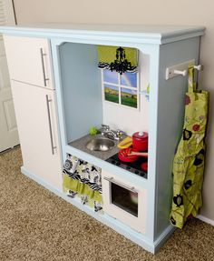 DIY Play Kitchen - real link, place to hang apron, on the side of kitchen. place to hang towel, oven handle