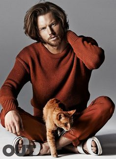 "Hampus Lück at Wilhelmina with Garfield in ""Pussy Riot: 14 Supermodels, 10 Cats, One Fab (and Furry) Portfolio"" by Giampaolo Sgura for the Out Magazine June-July 2014 Issue."
