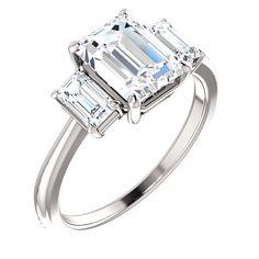 Emerald cut diamond three stone ring in platinum