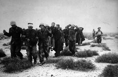 Prisoners, including some wounded, coming into Tobruk, Lybia, under British armed escort, December 1941