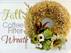 """Autumn Coffee Filter Wreath -- Hot glue coffee filters to a 12"""" - 14"""" styrofoam wreath. Artichokes and sunflowers are the focal point items (remove all stems). Then choose smaller items for fillers around the focal pieces and hot glue them to the filters. Use twine to hang on the wall. I'D USE SOME BURLAP IN THERE SOMEPLACE..."""