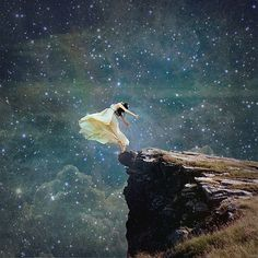 This picture embodies transcendentalism because it depicts a woman in white throwing herself into the unknown and and wanting to reach her dreams, which are depicted by the stars. She is letting herself go and following her intuition.