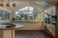 The Oak Timbers Kitchen is an example of a handcrafted Shere Kitchen to show the craftmanship of our work and give you ideas for your bespoke kitchen Gable Window, Timber Kitchen, Integrated Fridge, U Shaped Kitchen, Handmade Kitchens, Bespoke Kitchens, Family Kitchen, Dinning Table, Shaker Style