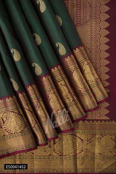 This Bottle Green Kanchipuram Silk Saree looks authentic. The graceful paisley motifs adorn the saree body beautifully. This saree is the ideal pick for the weddings. Nalli Silks, Kanjivaram Sarees Silk, Kanakavalli Sarees, Ethnic Sarees, Saris, Indian Sarees, Bottle Green Saree, Wedding Silk Saree, Kanchipuram Saree Wedding