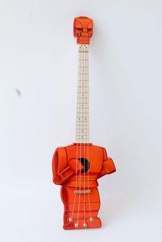 rock'em sock'em robot ukulele!! $900...and worth it. (not that i'm buying it, mind you.)
