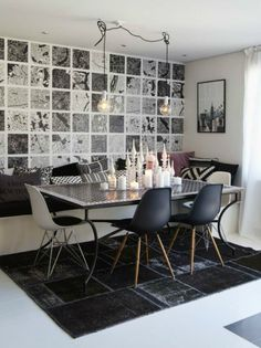 small black and white dining room with bench and eams chairs