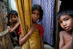 (Centre) Laboni, 10, lives in a Dhaka slum and attends a nearby school run by a UNICEF partner. Economic and gender disparities in Bangladesh hamper the fulfilment of child rights, including in education. Children from the poorest families are significantly less likely than their richest peers to be registered at birth, limiting their access to social services like school. For girls, the risk of early marriage presents additional threats to their educational achievement. ©UNICEF/Shehzad…