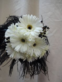 Fun with Feathers. Upgrade a Gerbera Bouquet with classy black feathers. Instant Haute Couture - Simply Regal by Julie