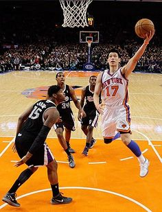 Jeremy Lin flying! New York Knicks point guard Jeremy Lin drives past  theSacramento KingsDeMarcus Cousins