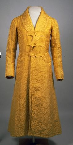 A banyan is an 18th century men's garment often worn as a morning gown, dressing gown or informal coat. This 19th century banyan is made from 18th century quilted gold patterned silk and is an example of a more fitted, coat-like style of banyan. 1835-1840 (garment); 1740-1790 (material) 1995.194.3 | American Textile History Museum