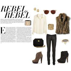 rebel, rebel.  leather leggings, faux fur vest, gucci cuff.