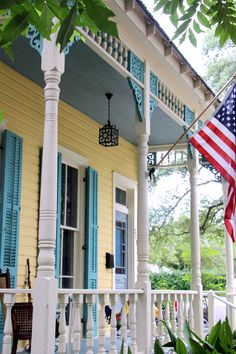 Haint Blue porch ceiling and louvered shutters on a three bay shotgun raised cottage in Old Mandeville, LA Door Paint Colors, Exterior Paint Colors, Paint Colors For Home, House Colors, Louvered Shutters, House Shutters, Haint Blue Porch Ceiling, Blue Shades Colors, Creole Cottage