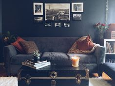 My newly decorated family room! Dark walls, blue couch, vintage, living room,