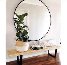 I LOVE this oversized circular mirror rather than a floor-length mirror!