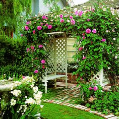 What a stunning place to 'sit and smell the climbing roses' ... arbors are a fantastic vertical garden structure to use and this one really makes an entrance!   The Micro Gardener