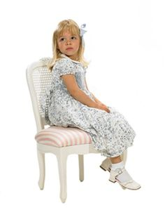 This Petite French Chair with Caning in Antico White from Art for Kids features a delightful pink and white stripe seat and clean white finish