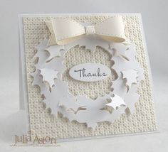 Christmas card ... white on white ...wreath of holly leaves ... cute paper bow with pierced edges ...