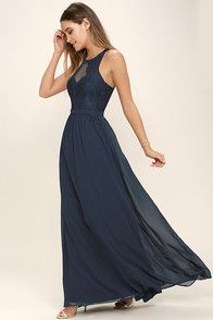 """From posh prom or lavish cocktail party, and from sea to shining sea, the Bariano Ocean of Elegance Grey Maxi Dress will have you in the lap of luxury wherever you may go! Crisp grey Georgette starts this exquisite ensemble off with tank straps (joined by sheer off-the-shoulder straps) that support a fitted bodice with a plunging sweetheart neckline, and elegant ruching details. Additional ruching delicately encircles an empire waistline, while a floor-length maxi with a stunning 31"""" sid..."""