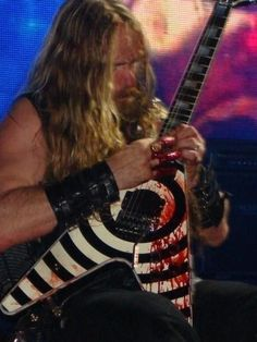 http://m.youtube.com/watch?v=8Ce9hXS6xjo I love guitar solos. they have so much power, energy and emotion behind them. My personal favourite guitar solo is this one of Zakk Wylde playing In This River live. This song is about his deceased friend  and legendary guitarist,Dimebag Darrell. http://www.youtube.com/watch?v=m3tXTrYe7vA Here's the video of him bleeding in the picture