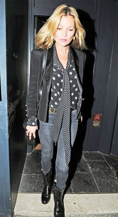 Kate Moss wears a printed blouse with skinny jeans, black boots and a blazer.