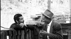 Gilbert Madrid, left, and Johnny Johnson visiting over Johnson's gate in Chavez Ravine in 1949.