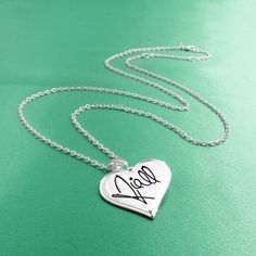 One Direction 'Niall Signature' Heart Necklace ($18) ❤ liked on Polyvore