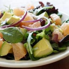 A fresh, healthy combination: avocado, grapefruit, and crisp greens and onions.