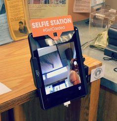 selfie station at the library - selfie with book recommendations? Could possibly use for video book recommendations/reviews.