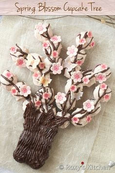 Spring Blossom Tree Made Out of Cupcakes | Roxy's Kitchen #cupcakes #Spring #fondant #dessert #flowers #butterflies #tree #branches...