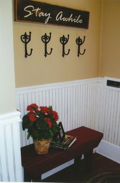 entry door signage with hooks