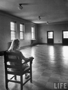 Woman sitting alone in room, in hospital that studies mental disorders (1949 Herbert Gehr, LIFE Magazine)