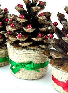 Glue pine cones into a bottle top,wrap brown string around the bottom to create a pretty base, then stick on sparkly beads as baubles. Decorate the base with a sweet bow and you have a lovely little mini tree for the mantlepiece.