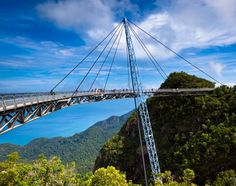 One of the world's most stunning pieces of architecture, the Langkawi Sky Bridge allows trailblazers to walk among the lush, tropical treetops of Pulau Langkawi, Malaysia. The pedestrian bridge, completed in 2005, is 410 feet long and hangs an astonishing 2,300 feet above sea level.