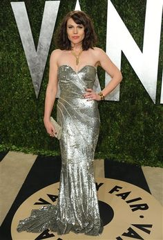 Actress Clea DuVall wears a silver sequin strapless gown from Pamella Roland' Pre-Fall 2013 Collection at the Vanity Fair Academy Awards party at Sunset Tower in West Hollywood on Feb. 24, 2013. || Jordan Strauss / Invision / AP
