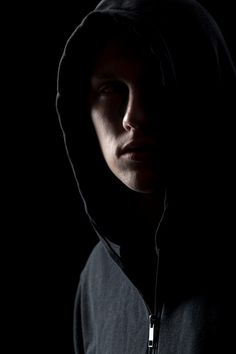 Stock image of 'Portrait of mysterious man in hoodie in the dark, dangerous criminal scarcely visible in the dusk' Portrait Photography Men, Modern Photography, Creative Photography, Dark Portrait, Mysterious Photography, Low Key Portraits, Dark Men, Dark Images, Sad Pictures