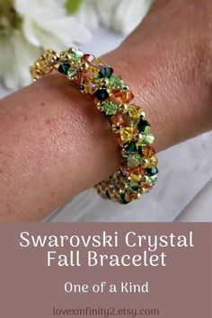 This gorgeous Swarovski Crystal beadwork bracelet is handcrafted with 4mm green, orange, yellow, and peridot bicone Swarovski crystals. Extender chain adjustable bracelet. One of a kind.