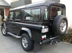 Land Rover SVX 110 Defender 2008. Satin Black body wrap decals. Tubular Side Runner Steps and Rear Folding Step.