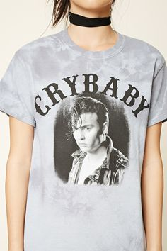 """A knit tee featuring """"Crybaby"""" and a Johnny Depp graphic, a tie-dye design, round neckline, and short sleeves."""