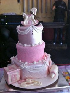 elegant baby shower cake with chocolate molds.