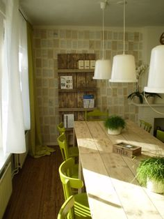 Such a fresh color scheme with the neutrals and pops of grass green. The wall is covered in old book pages as well!