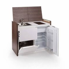 Small Kitchen Designs Compact all-in-one kitchen unit hides stove, fridge and dishwasher (Video) : TreeHugger - Perfect for tiny spaces, this multifunctional unit can be used as a kitchen, storage and workspace. First Kitchen, Mini Kitchen, Smart Kitchen, Kitchen Small, Kitchen Storage Units, Food Storage Boxes, Küchen Design, Layout Design, House Design